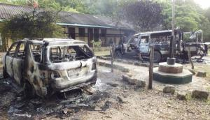 Wreckages of burnt cars are seen outside the Mpeketoni police station after unidentified gunmen attacked coastal Kenyan town of Mpeketoni